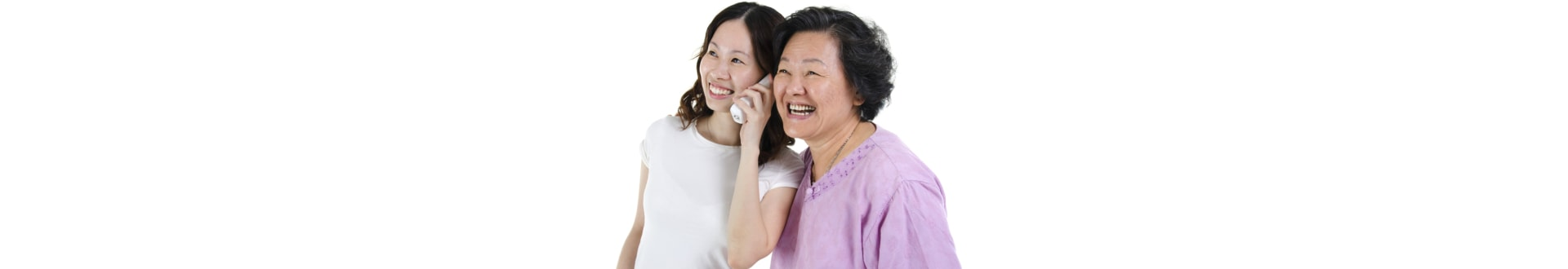 Portrait of Asian adult daughter calling on phone, sharing with senior mother and smiling